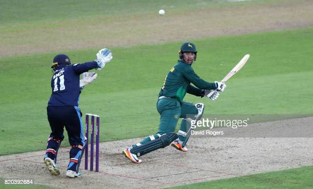Brendan Taylor of Nottinghamshire steers the ball past Daryn Smit for four runs during the NatWest T20 Blast match between Nottinghamshire Outlaws...