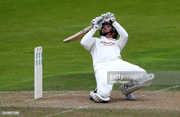 Brendan Taylor of Nottinghamshire stumbles as he is caught out by Tom Smith off the bowling of Jordan Clark during the Specsavers County Championship...
