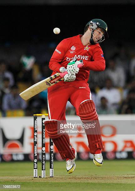 Brendan Taylor of Zimbabwe avoids a bouncer from Shaun Tait of Australia during the 2011 ICC World Cup Group A match between Australia and Zimbabwe...