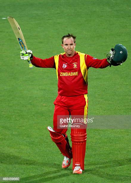 Brendan Taylor of Zimbabwe celebrates making his century during the 2015 ICC Cricket World Cup match between Zimbabwe and Ireland at Bellerive Oval...