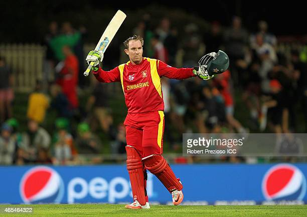 Brendan Taylor of Zimbabwe celebrates scoring his century during the 2015 ICC Cricket World Cup match between Zimbabwe and Ireland at Bellerive Oval...