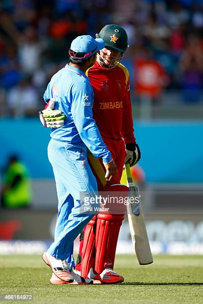 Brendan Taylor of Zimbabwe is congratulated by Suresh Raina of Zimbabwe as he leaves the field after making 138 runs during the 2015 ICC Cricket...