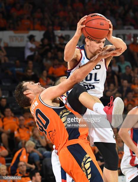 Brendan Teys of the 36ers collects a rebound over Alex Loughton of the Taipans during the round three NBL match between the Cairns Taipans and the...