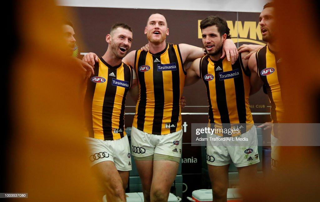 L-R Brendan Whitecross, Jarryd Roughead and Ben Stratton of the Hawks sing the team song during the 2018 AFL round 18 match between the Carlton Blues and the Hawthorn Hawks at Etihad Stadium on July 22, 2018 in Melbourne, Australia.
