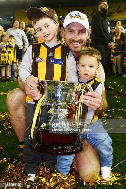 Brendan Whitecross of the Box Hilll Hawks and his kids celebrate the win with the premiership cup during the VFL Grand Final match between Casey and...