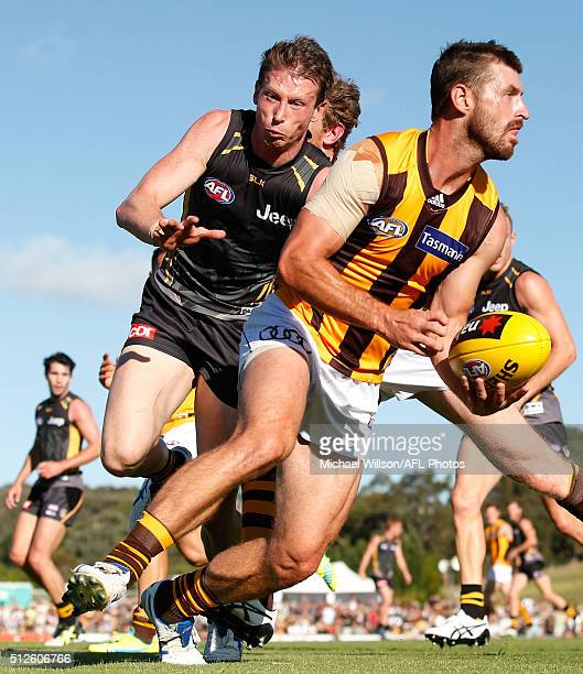 Brendan Whitecross of the Hawks is tackled by Dylan Grimes of the Tigers during the 2016 NAB Challenge match between Richmond Tigers and the Hawthorn...