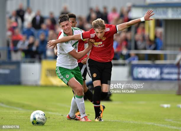 Brendan Williams of Manchester United and Eoin Toal of Northern Ireland during the NI Super Cup game between Manchester United u18s and Northern...
