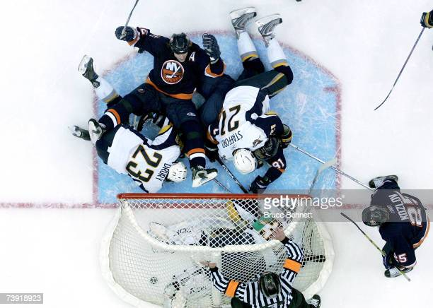 Brendan Witt of the New York Islanders falls back and reacts after referee Mike Leggo blows the whistle signaling no goal after the puck gets past...