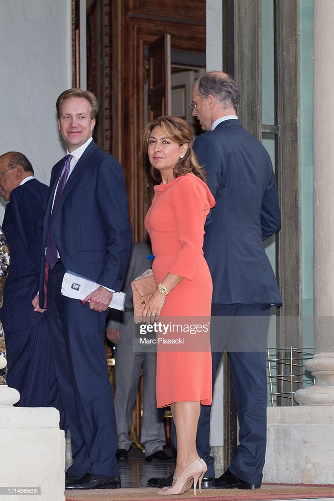 Brende Borge, managing director of the World Economic Forum, Kurt Bock (L), Chairman of the Board of Executive Directors, BASF SE and Arzuhan Dogan YALÇINDAG (C), Chairman of Dogan TV Holding (DTVH) arrive to attend a dinner at Elysee Palace on June 25, 2013 in Paris, France.