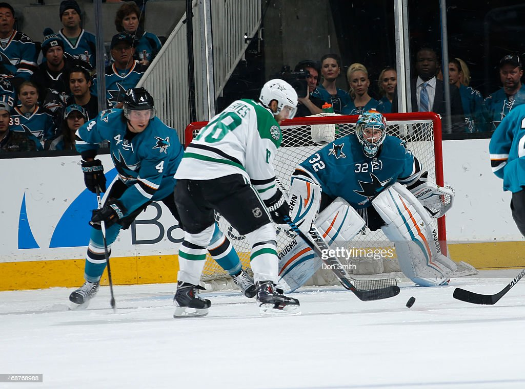 Brenden Dillon #4 and Alex Stalock #32 of the San Jose Sharks get in position for a shot on net against Patrick Eaves #18 of the Dallas Stars at the SAP Center on April 6, 2015 in San Jose, California .