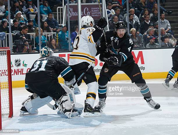 Brenden Dillon and Antti Niemi of the San Jose Sharks protect the net against Patrice Bergeron of the Boston Bruins during an NHL game on December 4,...