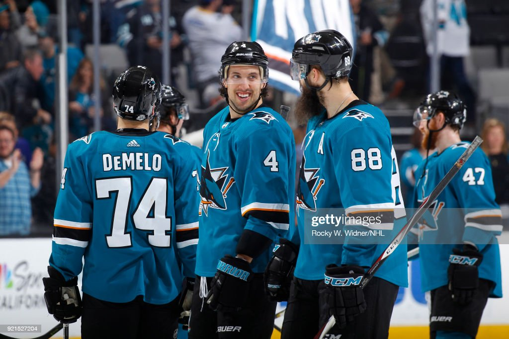 Brenden Dillon #4 and Brent Burns #88 of the San Jose Sharks celebrate after defeating the Vancouver Canucks at SAP Center on February 15, 2018 in San Jose, California.