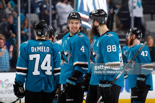 Brenden Dillon and Brent Burns of the San Jose Sharks celebrate after defeating the Vancouver Canucks at SAP Center on February 15 2018 in San Jose...