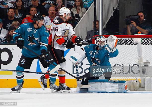 Brenden Dillon and Martin Jones of the San Jose Sharks protect the net against Jiri Sekac of the Anaheim Ducks during a NHL game at the SAP Center at...