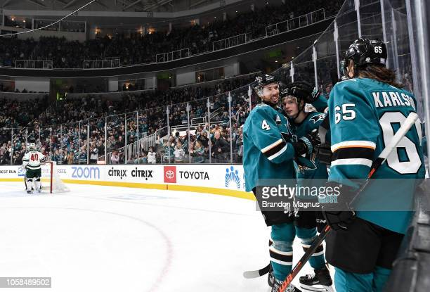 Brenden Dillon Antti Suomela and Erik Karlsson of the San Jose Sharks celebrate scoring a goal against the Minnesota Wild at SAP Center on November 6...