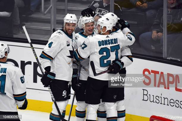 Brenden Dillon Joonas Donskoi Antti Suomela and Evander Kane of the San Jose Sharks celebrate after scoring a goal against the Los Angeles Kings at...