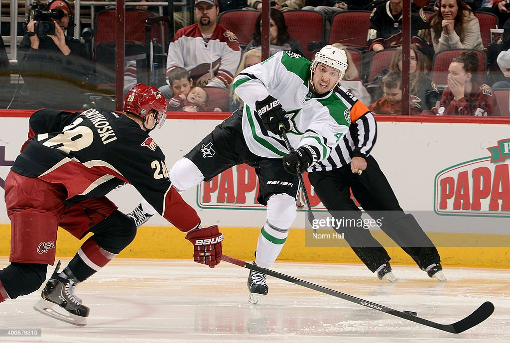 Brenden Dillon #4 of the Dallas Stars shoots the puck past Lauri Korpikoski #28 of the Phoenix Coyotes during the second period at Jobing.com Arena on February 4, 2014 in Glendale, Arizona.