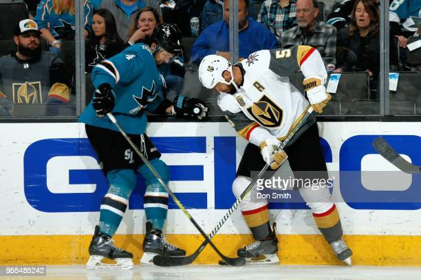 Brenden Dillon of the San Jose Sharks and Deryk Engelland of the Vegas Golden Knights battle for the puck in Game Six of the Western Conference...