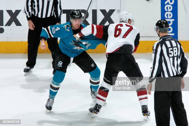 Brenden Dillon of the San Jose Sharks and Lawson Crouse of the Arizona Coyotes have a first period scuffle at SAP Center at San Jose on February 4...