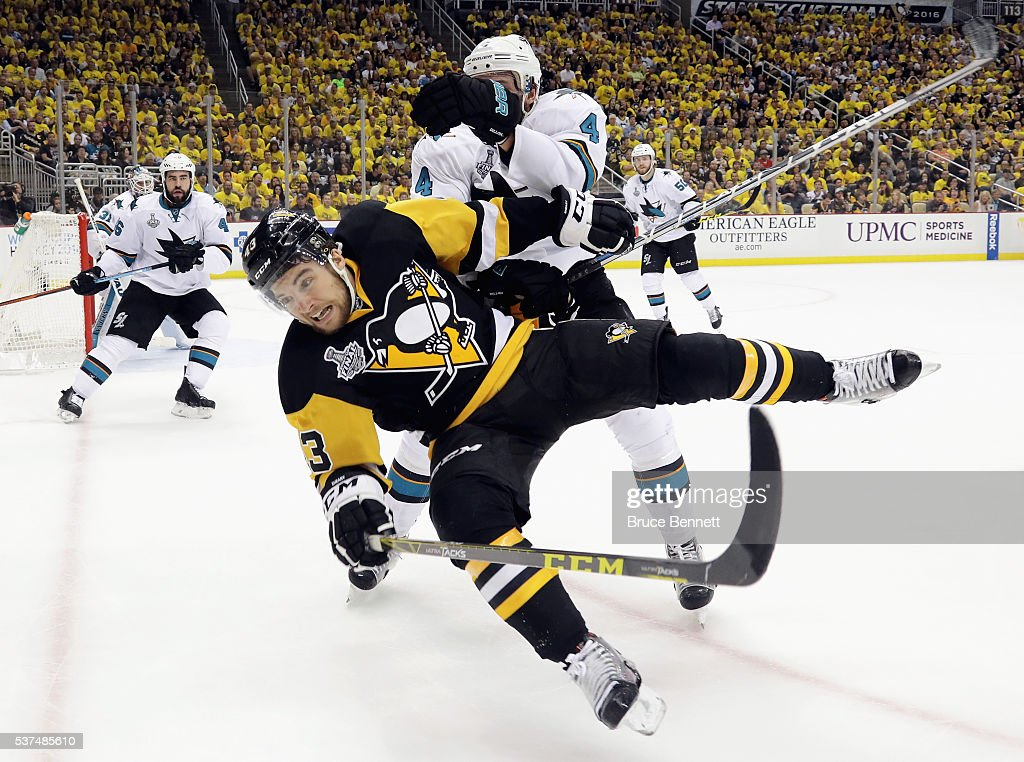 Brenden Dillon #4 of the San Jose Sharks checks Conor Sheary #43 of the Pittsburgh Penguins during the third period in Game Two of the 2016 NHL Stanley Cup Final at Consol Energy Center on June 1, 2016 in Pittsburgh, Pennsylvania.