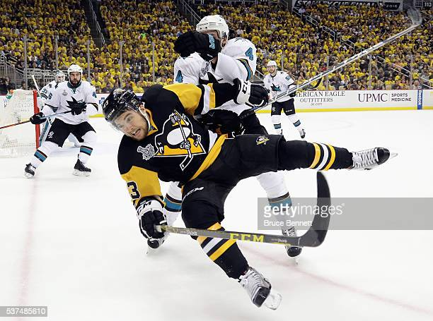 Brenden Dillon of the San Jose Sharks checks Conor Sheary of the Pittsburgh Penguins during the third period in Game Two of the 2016 NHL Stanley Cup...