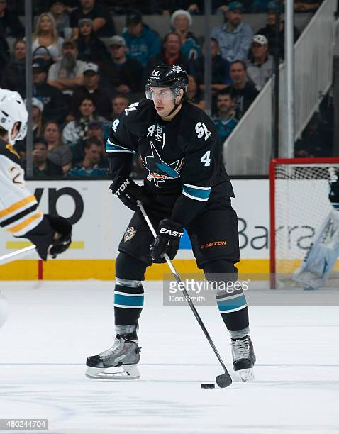Brenden Dillon of the San Jose Sharks handles the puck against the Boston Bruins during an NHL game on December 4, 2014 at SAP Center in San Jose,...