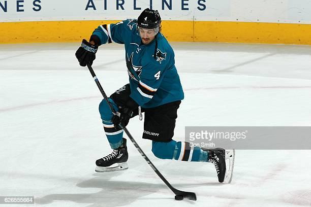 Brenden Dillon of the San Jose Sharks moves the puck during a NHL game against the Arizona Coyotes at SAP Center at San Jose on November 29, 2016 in...