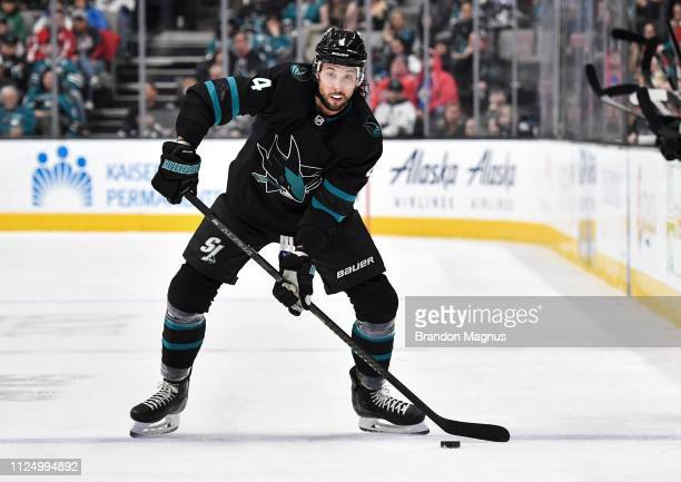 Brenden Dillon of the San Jose Sharks passes the puck ahead against the Washington Capitals at SAP Center on February 14 2019 in San Jose California