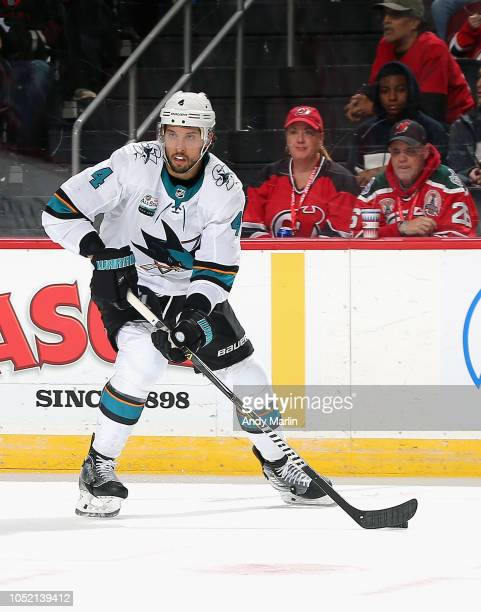 Brenden Dillon of the San Jose Sharks plays the puck against the New Jersey Devils during the game at Prudential Center on October 14 2018 in Newark...