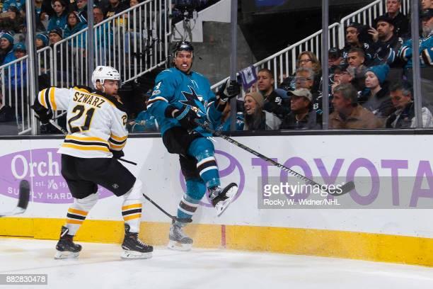Brenden Dillon of the San Jose Sharks skates against Jordan Szwarz of the Boston Bruins at SAP Center on November 18 2017 in San Jose California