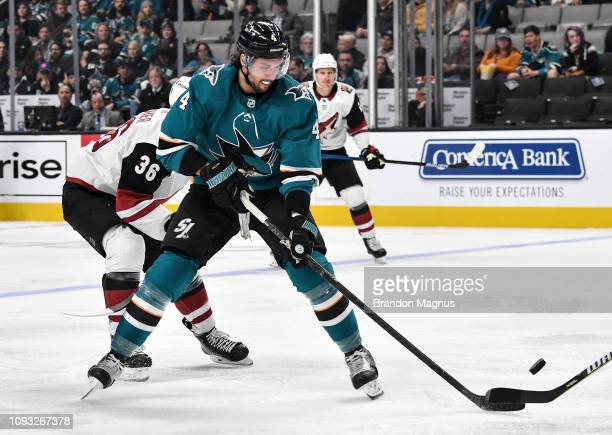 Brenden Dillon of the San Jose Sharks skates ahead with the puck against the Arizona Coyotes at SAP Center on February 2 2018 in San Jose California