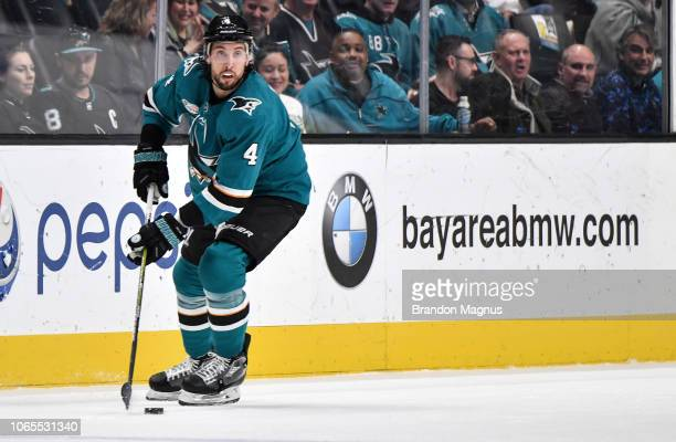 Brenden Dillon of the San Jose Sharks skates with the puck against the Minnesota Wild at SAP Center on November 6 2018 in San Jose California