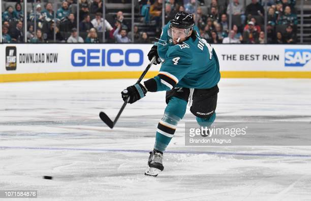 Brenden Dillon of the San Jose Sharks takes a shot on goal against the New Jersey Devils at SAP Center on December 10 2018 in San Jose California
