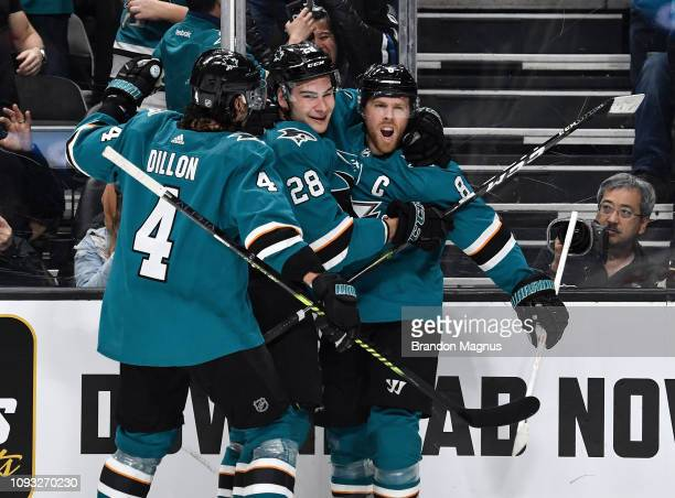Brenden Dillon Timo Meier and Joe Pavelski of the San Jose Sharks celebrate scoring a goal against the Arizona Coyotes at SAP Center on February 2...