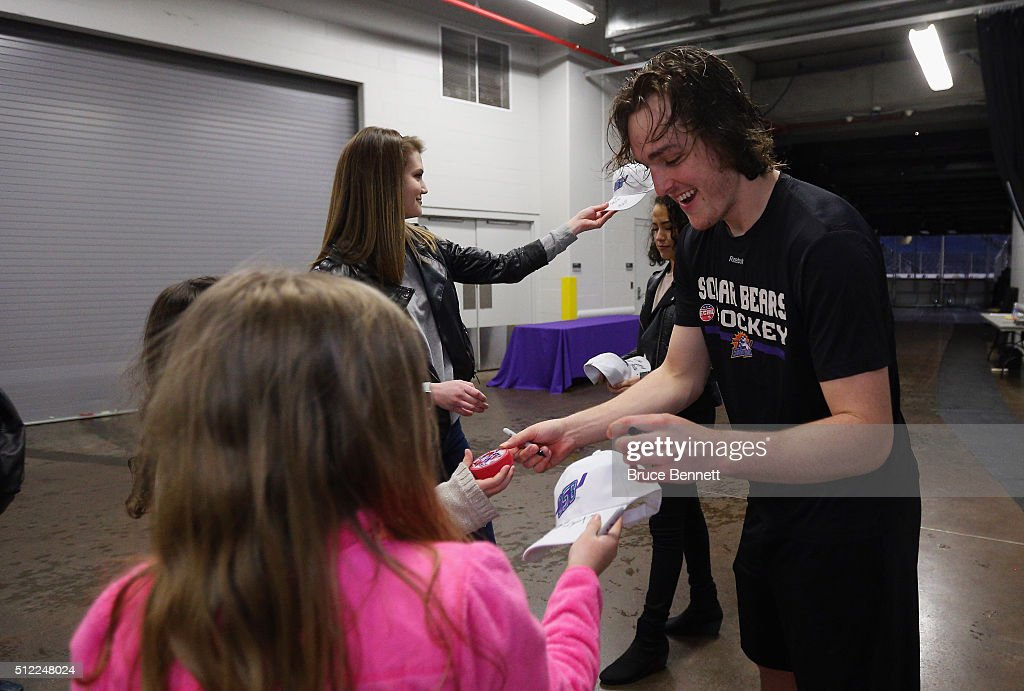 Brenden Miller #4 of Orlando Solar Bears signs autographs following a game against the Atlanta Gladiators at the Amway Center on February 13, 2016 in Orlando, Florida.