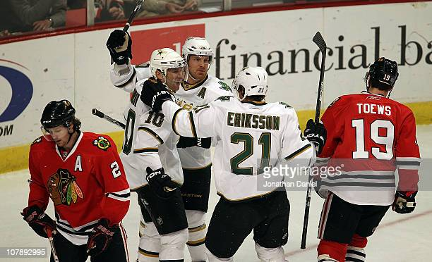 Brenden Morrow Brad Richards and Loui Eriksson of the Dallas Stars celebrate Morrows' 1st period goal as Duncan Kieth and Jonathan Toews of the...
