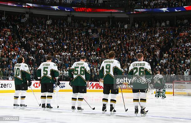 Brenden Morrow Darryl Sydor Sergei Zubov Mike Modano Jere Lehtinen and Marty Turco of the Dallas Stars stand for the singing of the national anthems...