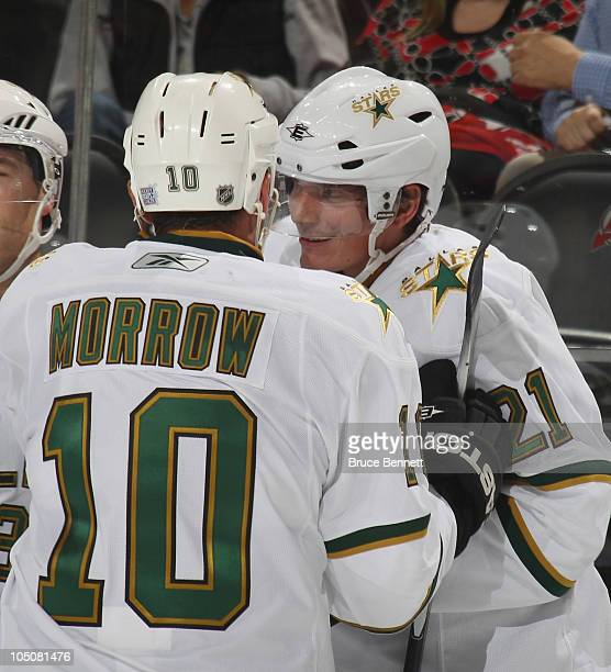 Brenden Morrow of the Dallas Stars congratulates Loui Eriksson on his overtime winning goal against the New Jersey Devils at the Prudential Center on...