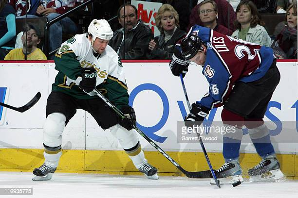Brenden Morrow of the Dallas Stars fights for the puck against JohnMichael Liles of the Colorado Avalanche during Game 4 of the Western Conference...