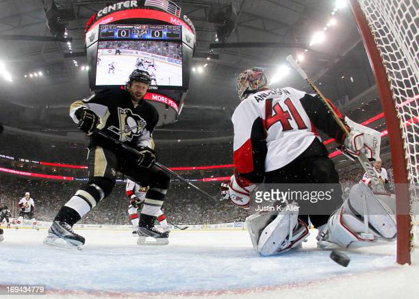 Brenden Morrow of the Pittsburgh Penguins scores in the first period past Craig Anderson of the Ottawa Senators in Game Five of the Eastern...