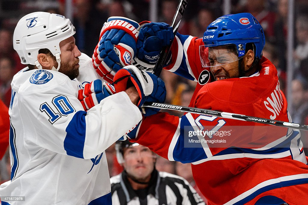 Brenden Morrow #10 of the Tampa Bay Lightning and Devante Smith-Pelly #21 of the Montreal Canadiens clash in Game One of the Eastern Conference Semifinals during the 2015 NHL Stanley Cup Playoffs at the Bell Centre on May 1, 2015 in Montreal, Quebec, Canada.