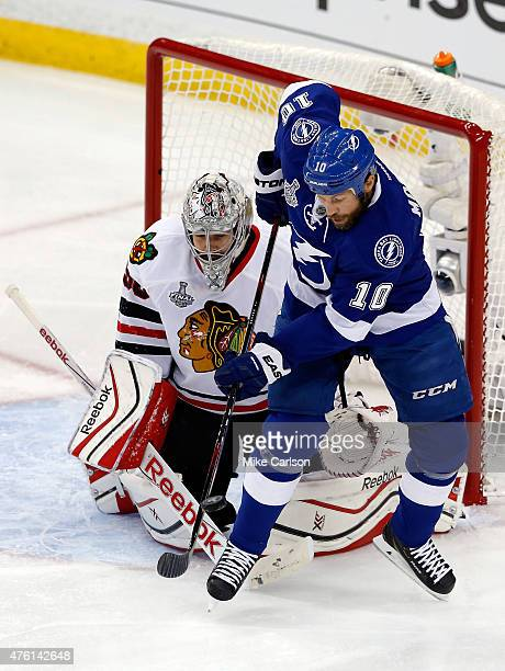 Brenden Morrow of the Tampa Bay Lightning sets up for a defelection against Corey Crawford of the Chicago Blackhawks during the first period in Game...