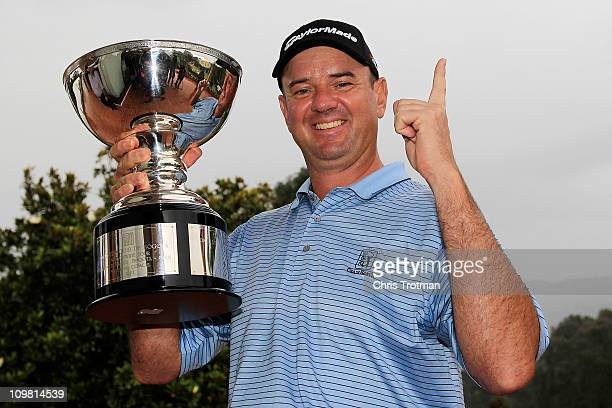 Brenden Pappas of South Africa poses with the trophy after winning the weather shortened Pacific Rubiales Bogota Open Presented by Samsung at Country...