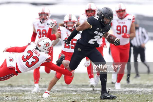Brenden Rice of the Colorado Buffaloes returns a punt for 81 yards for a touchdown against the Utah Utes in the second quarter at Folsom Field on...