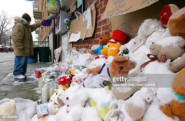 Brenden Sanchez looks at a makeshift memorial to Nixzmary Brown which includes a group of snowcovered teddy bears sitting in front of the...