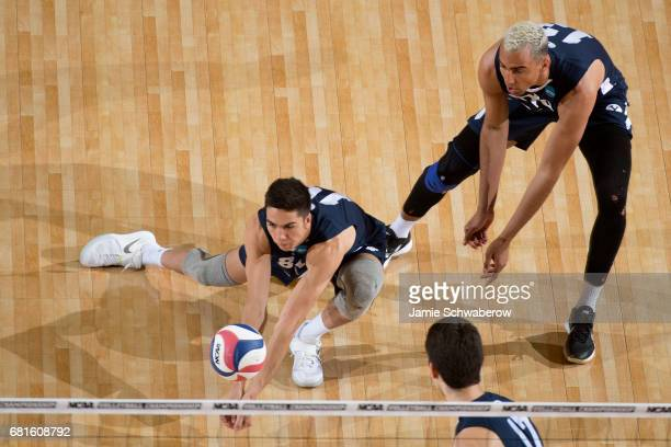Brenden Sander of Brigham Young University returns a serve against the Ohio State University during the Division I Men's Volleyball Championship held...