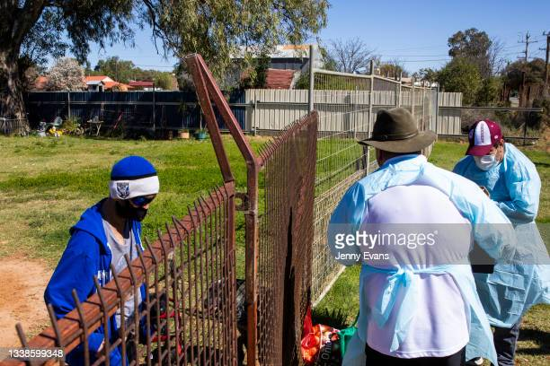 Brendon Adams and Bishop Columba distribute food to the community on September 06, 2021 in Wilcannia, Australia. After hearing locals in isolation...