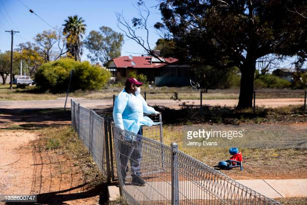 Brendon Adams talks to a resident before leaving supplies on September 06, 2021 in Wilcannia, Australia. After hearing locals in isolation were...