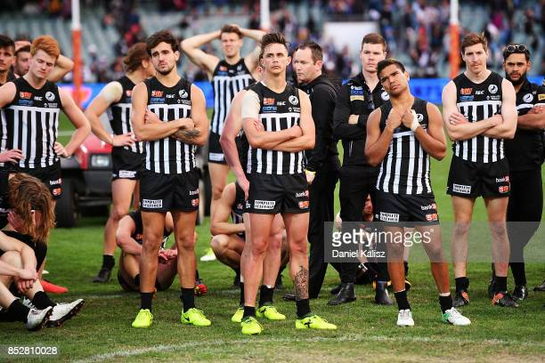 Brendon Ah Chee Riley Bonner and Jake Neade of the Magpies look on dejected after the SANFL Grand Final match between Port Adelaide and Sturt at AAMI...