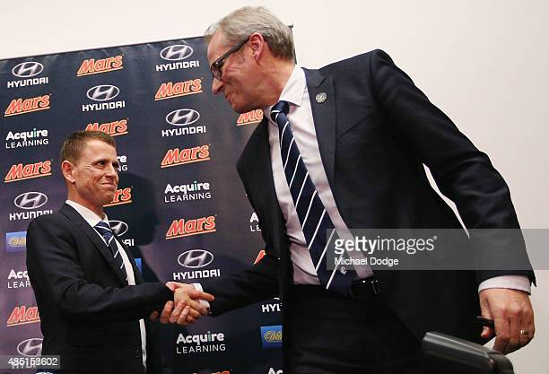 Brendon Bolton and CEO Steven Trigg shake hands after Bolton was announced as Carlton Football Club Senior Coach at Ikon Park on August 25 2015 in...